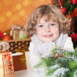 Happy child on the Christmas eve — Stock Photo #11889076