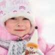 Child with snowman — Stock Photo