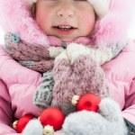 Child with Christmas balls — Stock Photo