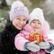 Happy family with Christmas gift — Stock Photo