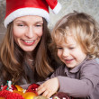 Woman and child in Christmas — Stock Photo #12461378