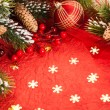 Foto Stock: Christmas decorations on red