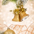 Christmas bells against lights — Stockfoto