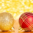 Christmas balls against lights — Stock Photo
