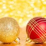 Christmas balls against lights — Stock Photo