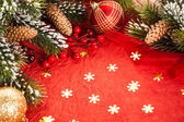 Christmas decorations on red — Stock Photo
