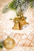 Christmas bells against lights — Stock Photo
