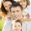 Stock Photo: Happy family playing outside