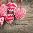 Hearts on wooden background — Stock Photo