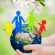 Earth with family in childrens hands — Stock Photo