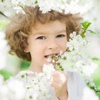 Happy child with spring flower — Stock Photo