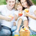 Family drinking apple juice — Stock Photo