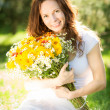 Woman holding bouquet of flowers — Stock Photo