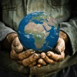 Earth in hand — Stockfoto