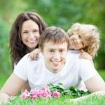 Family having fun outdoors — Stock Photo #21384547