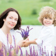 Child and woman in spring — Stock Photo #21384707