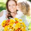 Child and woman with bouquet of flowers - Stockfoto