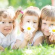 Children with flowers in park — Stock Photo