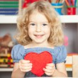 Child holding heart — Stock Photo