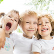 Low angle view portrait of funny children — Stock Photo