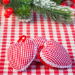 Hearts on gingham tablecloth — Stock Photo #21384777