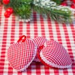 Hearts on gingham tablecloth — Stock Photo