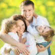 Happy family in spring — Stock Photo
