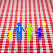 Stock Photo: 3d family on gingham tablecloth