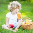 Royalty-Free Stock Photo: Child drinking apple juice