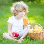 Child drinking apple juice — Stock Photo