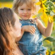 Child with sunflower — Stock Photo #21384911