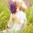 Happy child holding lavender — Stock Photo