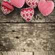 Hearts on wooden background — Stock Photo #21384971