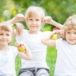 Happy children with apples — Stock Photo