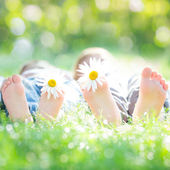 Active couple lying on grass — Stock Photo