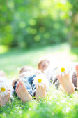 Happy family lying on grass — Stock Photo