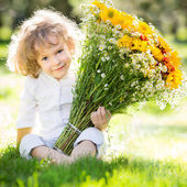 Child with bouquet flowers — Stock Photo