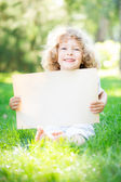 Child with paper blank — Stock Photo