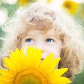 Beautiful child with sunflower — Stock Photo