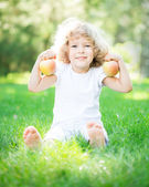 Child with apples — Stock Photo