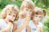 Girls eating ice-cream — Stock Photo