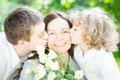 Family having picnic outdoors — Stock Photo