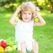 Happy child sitting on green grass and playing with fruits and vegetables in spring park. healthy eating concept — Stock Video #21381637