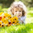 Child with bouquet of flowers — Stock fotografie