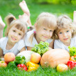 Stock Photo: Children having picnic outdoors