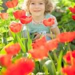 Child in spring garden — Stock Photo #21556367