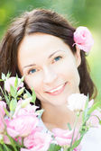 Beautiful woman with bouquet of flowers — Stock Photo