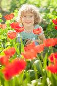 Child in spring garden — Stock Photo
