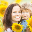 Happy family in sunflower field — Stock Photo #22150027