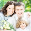 Happy family with spring flowers — Stock Photo #22150037